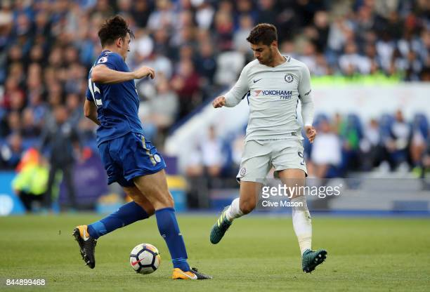 Alvaro Morata of Chelsea attempts to get past Harry Maguire of Leicester City during the Premier League match between Leicester City and Chelsea at...