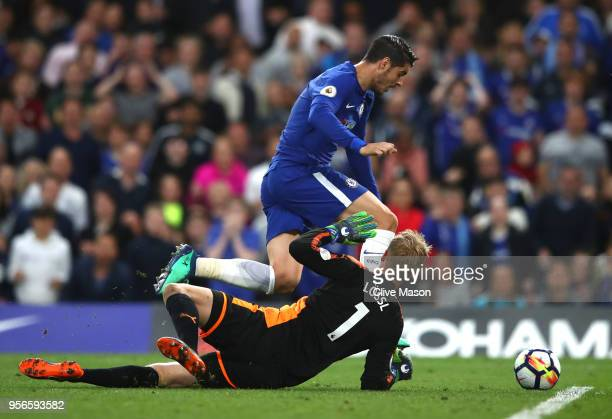 Alvaro Morata of Chelsea attempts to take the ball around Kasper Schmeichel of Leicester City during the Premier League match between Chelsea and...