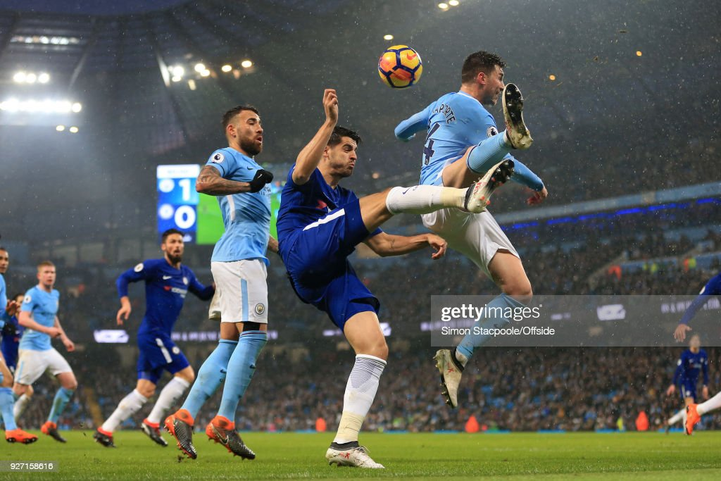 Alvaro Morata of Chelsea battles with Aymeric Laporte of Man City during the Premier League match between Manchester City and Chelsea at the Etihad Stadium on March 4, 2018 in Manchester, England.