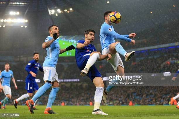 Alvaro Morata of Chelsea battles with Aymeric Laporte of Man City during the Premier League match between Manchester City and Chelsea at the Etihad...