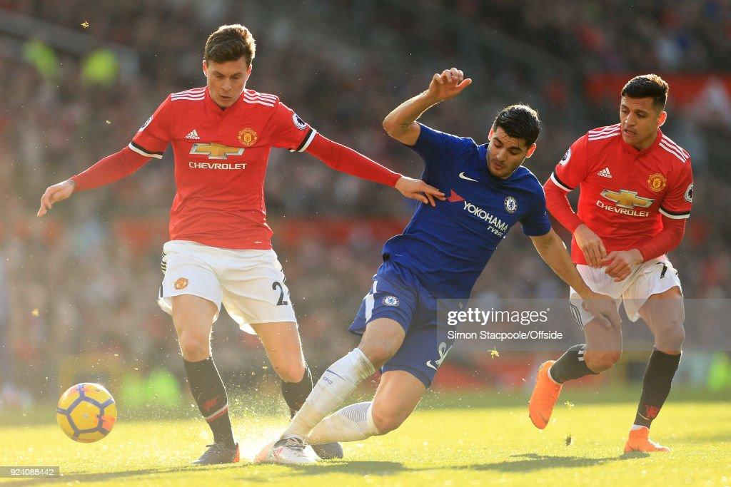 Alvaro Morata of Chelsea battles with Victor Lindelof of Man Utd (L) and Alexis Sanchez of Man Utd during the Premier League match between Manchester United and Chelsea at Old Trafford on February 25, 2018 in Manchester, England.