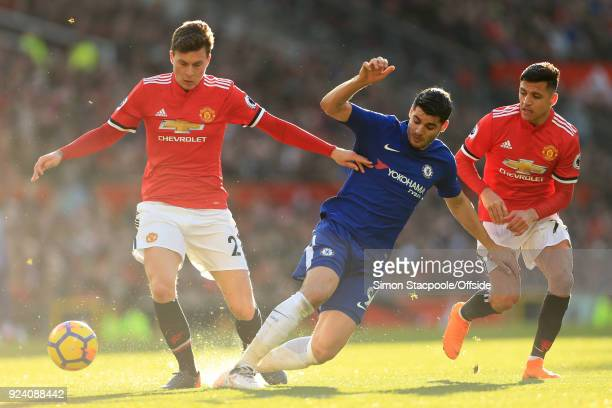 Alvaro Morata of Chelsea battles with Victor Lindelof of Man Utd and Alexis Sanchez of Man Utd during the Premier League match between Manchester...
