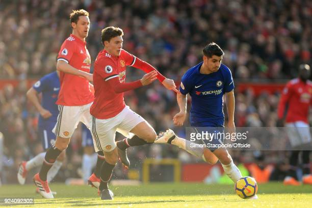 Alvaro Morata of Chelsea battles with Victor Lindelof of Man Utd during the Premier League match between Manchester United and Chelsea at Old...