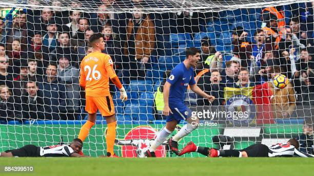 Alvaro Morata of Chelsea celebrates after scoring his sides second goal as Karl Darlow of Newcastle United reacts during the Premier League match...