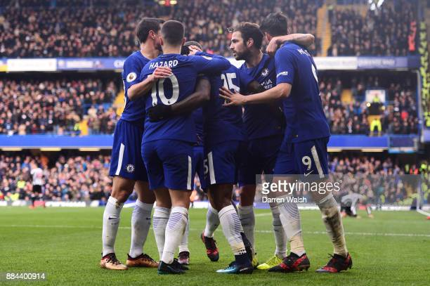 Alvaro Morata of Chelsea celebrates after scoring his sides second goal with his Chelsea team mates during the Premier League match between Chelsea...