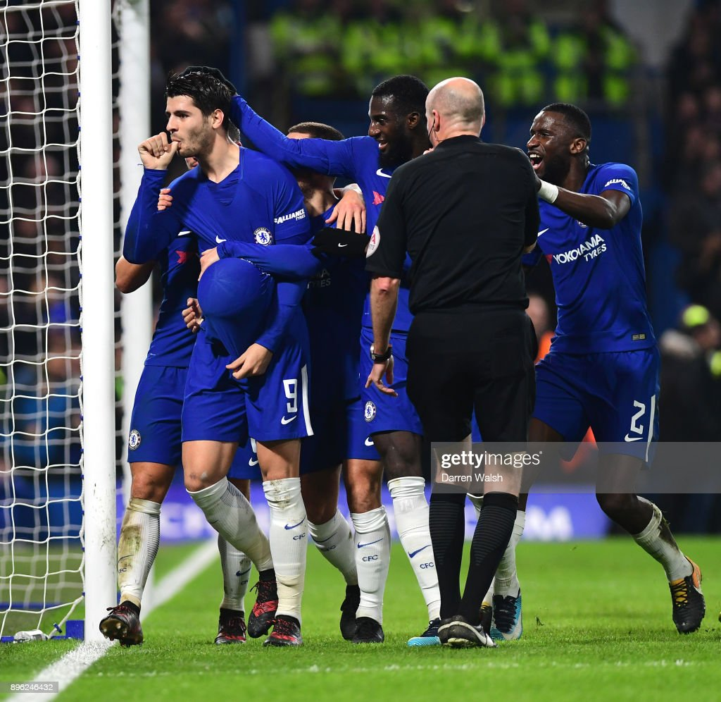 Alvaro Morata of Chelsea celebrates after scoring his sides second goal with his Chelsea team mates during the Carabao Cup Quarter-Final match between Chelsea and AFC Bournemouth at Stamford Bridge on December 20, 2017 in London, England.