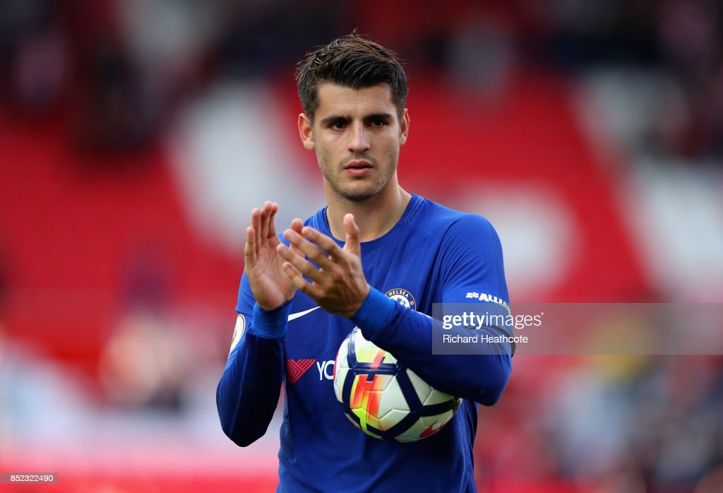 Alvaro Morata of Chelsea celebrates his team's 4-0 victory and his hat trick with the match ball after the Premier League match between Stoke City and Chelsea at Bet365 Stadium on September 23, 2017 in Stoke on Trent, England.