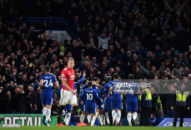 Alvaro Morata of Chelsea celebrates scoring his sides first goal with his team mates during the Premier League match between Chelsea and Manchester...