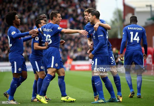 Alvaro Morata of Chelsea celebrates scoring the opening goal with his team mates during the Premier League match between Stoke City and Chelsea at...