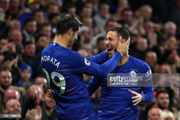 Alvaro Morata of Chelsea celebrates with teammate Eden Hazard after scoring his team's second goal during the Premier League match between Chelsea FC...