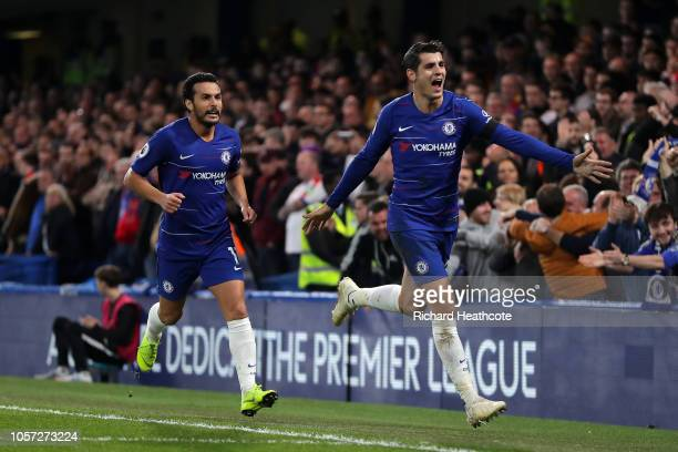 Alvaro Morata of Chelsea celebrates with teammate Pedro after scoring his team's first goal during the Premier League match between Chelsea FC and...