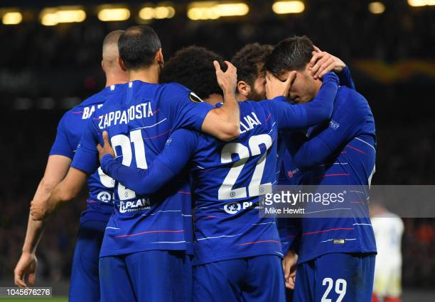 Alvaro Morata of Chelsea celebrates with teammates after scoring his team's first goal during the UEFA Europa League Group L match between Chelsea...