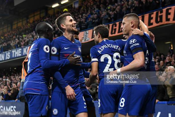 Alvaro Morata of Chelsea celebrates with teammates after scoring his team's first goal during the Premier League match between Chelsea FC and Crystal...