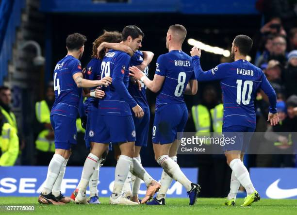 Alvaro Morata of Chelsea celebrates with teammates after scoring his team's first goal during the FA Cup Third Round match between Chelsea and...