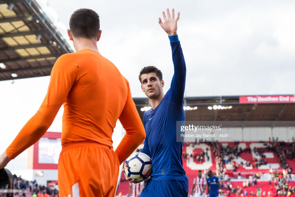 Alvaro Morata of Chelsea celebrates with the match ball at full time during the Premier League match between Stoke City and Chelsea at Bet365 Stadium on September 23, 2017 in Stoke on Trent, England.