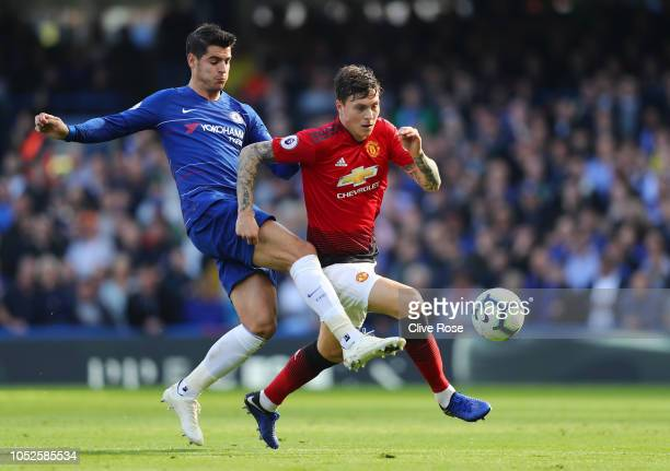 Alvaro Morata of Chelsea challenges for the ball with Victor Lindelof of Manchester United during the Premier League match between Chelsea FC and...