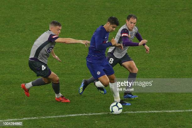 Alvaro Morata of Chelsea controls the ball under pressure from Shane Lowry and Neil Kilkenny of the Glory during the international friendly between...