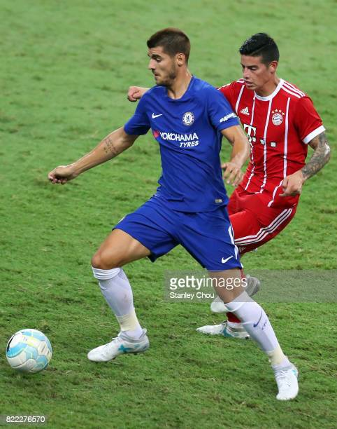 Alvaro Morata of Chelsea holds off James Rodriguez of Bayern Munich during the International Champions Cup match between Chelsea FC and FC Bayern...
