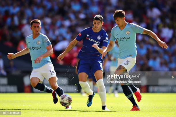 Alvaro Morata of Chelsea is challenged by Aymeric Laporte and John Stones both of Manchester City during the FA Community Shield match between...