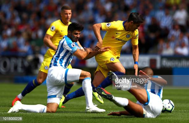 Alvaro Morata of Chelsea is challenged by Christopher Schindler of Huddersfield Town and Mathias Zanka Jorgensen of Huddersfield Town during the...