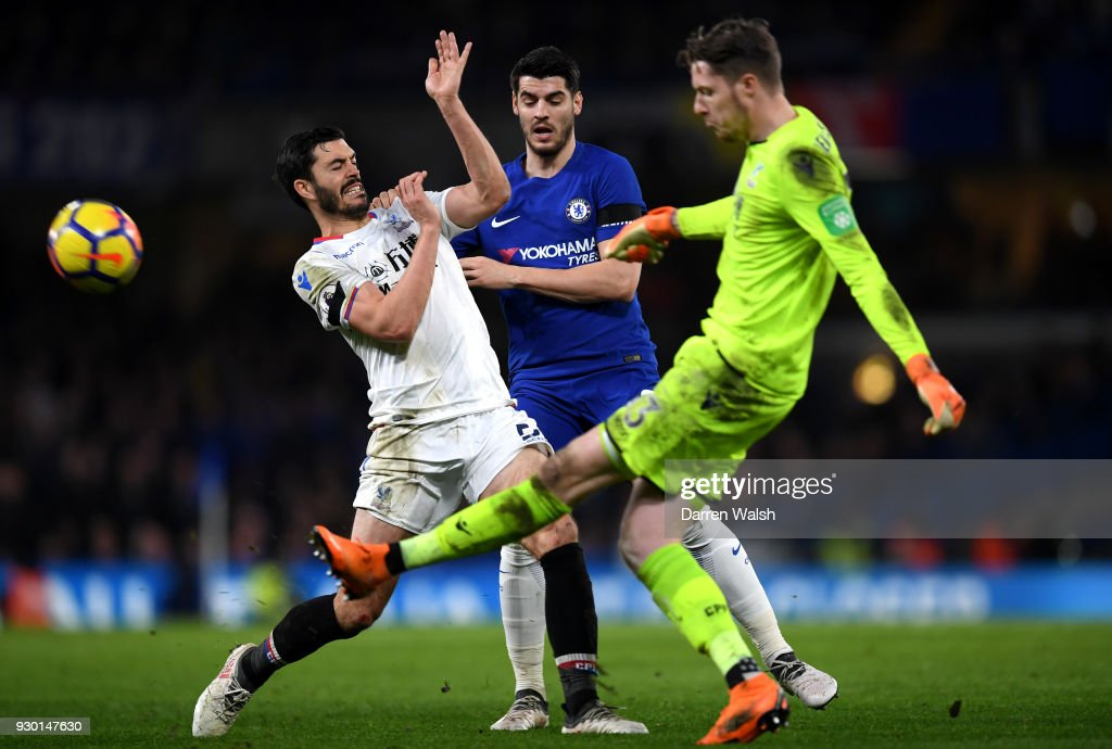Alvaro Morata of Chelsea is challenged by James Tomkins of Crystal Palace as Wayne Hennessey of Crystal Palace clears the ball during the Premier League match between Chelsea and Crystal Palace at Stamford Bridge on March 10, 2018 in London, England.