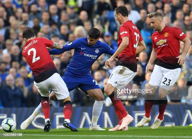 Alvaro Morata of Chelsea is challenged by Victor Lindelof and Nemanja Matic of Manchester United during the Premier League match between Chelsea FC...