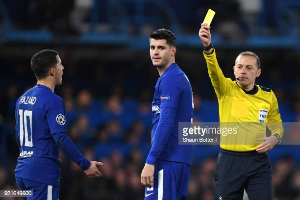 Alvaro Morata of Chelsea is shown a yellow card by referee Cüneyt Çakir during the UEFA Champions League Round of 16 First Leg match between Chelsea...