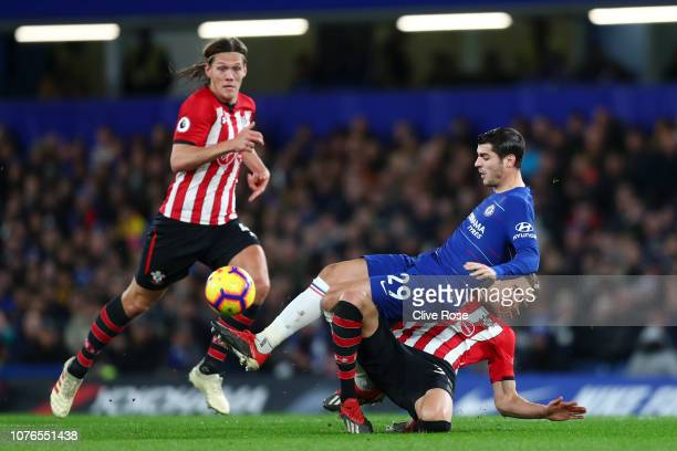 Alvaro Morata of Chelsea is tackled by Jan Bednarek of Southampton during the Premier League match between Chelsea FC and Southampton FC at Stamford...