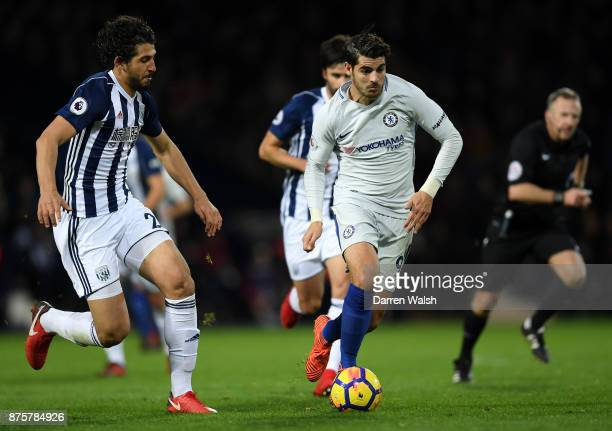 Alvaro Morata of Chelsea is tracked by Ahmed ElSayed Hegazi of West Bromwich Albion during the Premier League match between West Bromwich Albion and...
