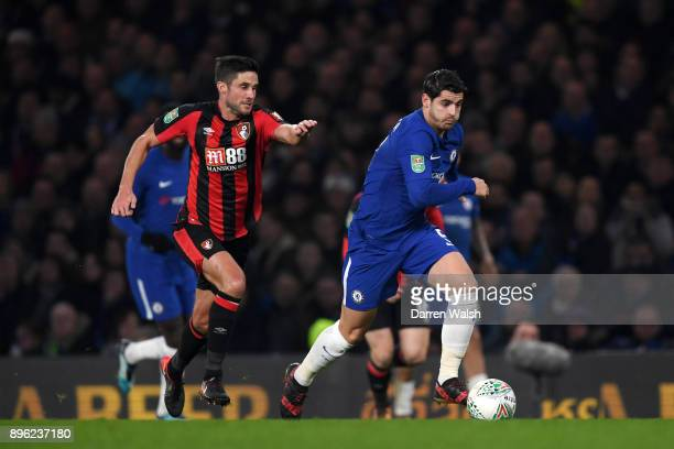 Alvaro Morata of Chelsea runs with the ball away from pressure of Andrew Surman of AFC Bournemouth during the Carabao Cup QuarterFinal match between...
