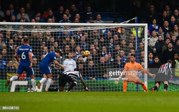 Alvaro Morata of Chelsea scores Chelsea's second goal past Newcastle United's Goalkeeper Karl Darlow during the Premier League match between Chelsea...