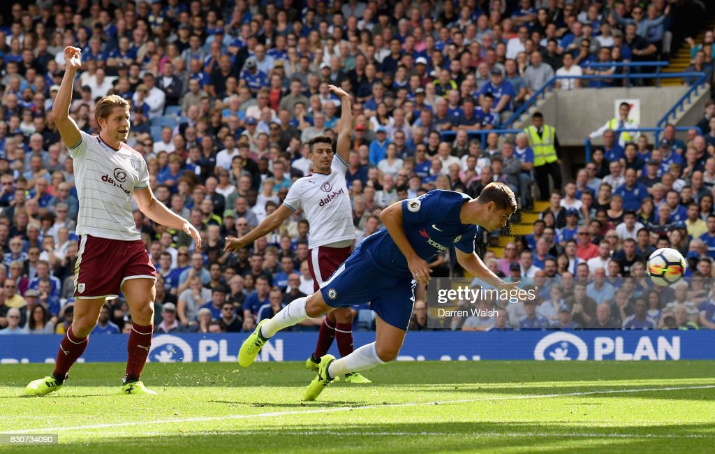 Alvaro Morata of Chelsea scores his sides first goal as Burnley players appeal for offside during the Premier League match between Chelsea and Burnley at Stamford Bridge on August 12, 2017 in London, England.