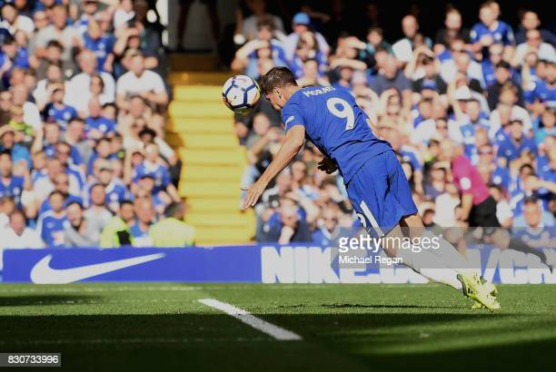 Alvaro Morata of Chelsea scores his sides first goal during the Premier League match between Chelsea and Burnley at Stamford Bridge on August 12 2017...