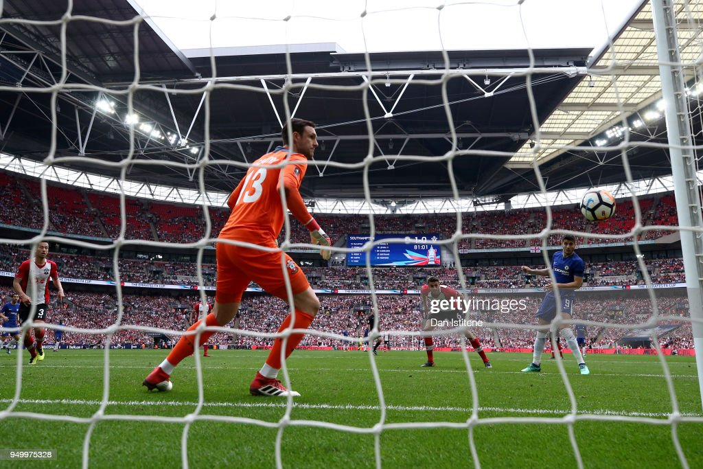 Alvaro Morata of Chelsea scores his side's second goal past Alex McCarthy of Southampton during the The Emirates FA Cup Semi Final match between Chelsea and Southampton at Wembley Stadium on April 22, 2018 in London, England.
