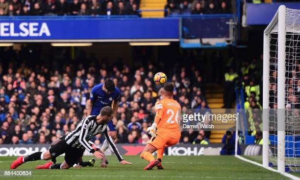 Alvaro Morata of Chelsea scores his sides second goal past Karl Darlow of Newcastle United during the Premier League match between Chelsea and...