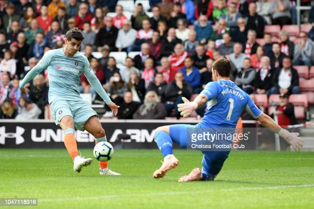 Alvaro Morata of Chelsea scores his team's third goal past Alex McCarthy of Southampton during the Premier League match between Southampton FC and...