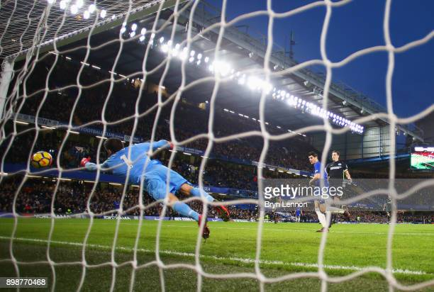 Alvaro Morata of Chelsea scores their first goal past Mathew Ryan of Brighton and Hove Albion during the Premier League match between Chelsea and...
