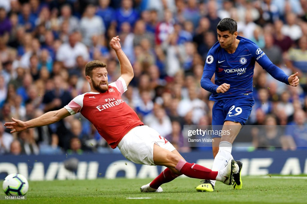 Alvaro Morata of Chelsea shoots and scores his side's second goal during the Premier League match between Chelsea FC and Arsenal FC at Stamford Bridge on August 18, 2018 in London, United Kingdom.