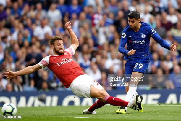 Alvaro Morata of Chelsea shoots and scores his side's second goal during the Premier League match between Chelsea FC and Arsenal FC at Stamford...
