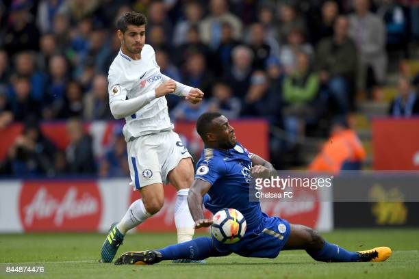 Alvaro Morata of Chelsea shoots as Wes Morgan of Leicester City attempts to block during the Premier League match between Leicester City and Chelsea...