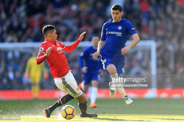 Alvaro Morata of Chelsea skips past Chris Smalling of Man Utd during the Premier League match between Manchester United and Chelsea at Old Trafford...