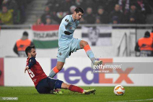 Alvaro Morata of Chelsea takes a shot as he is challenged by Boban Nikolov of Vidi FC during the UEFA Europa League Group L match between Vidi FC and...