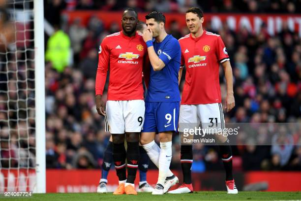Alvaro Morata of Chelsea talks to Romelu Lukaku of Manchester United during the Premier League match between Manchester United and Chelsea at Old...