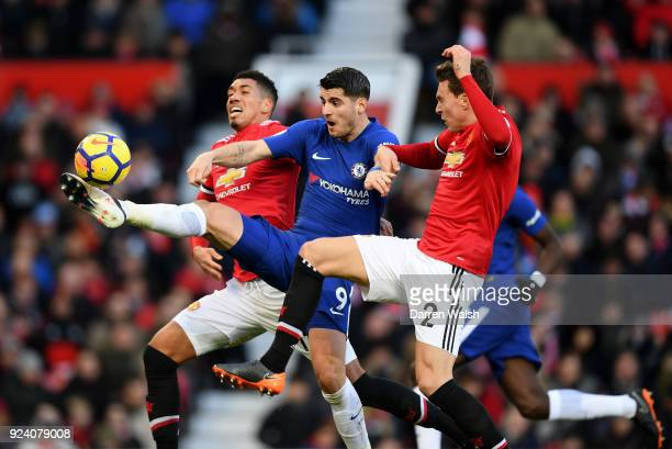Alvaro Morata of Chelsea Victor Lindelof and Chris Smalling of Manchester United compete for the ball during the Premier League match between...