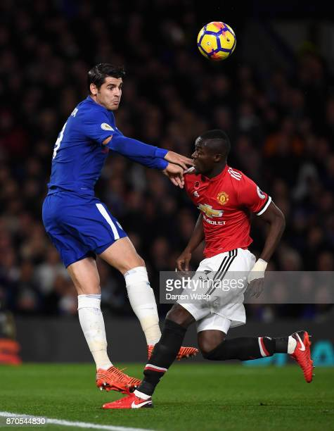 Alvaro Morata of Chelsea wins a header over Eric Bailly of Manchester United during the Premier League match between Chelsea and Manchester United at...
