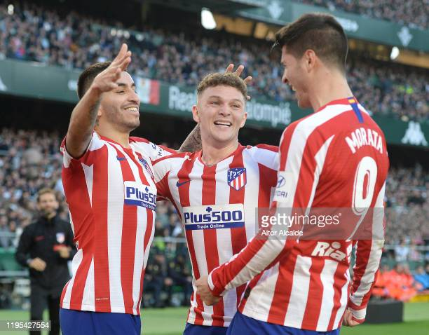 Alvaro Morata of Club Atletico de Madrid celebrates after scoring his sides second goal with teammates Angel Correa and Kieran Trippier during the...