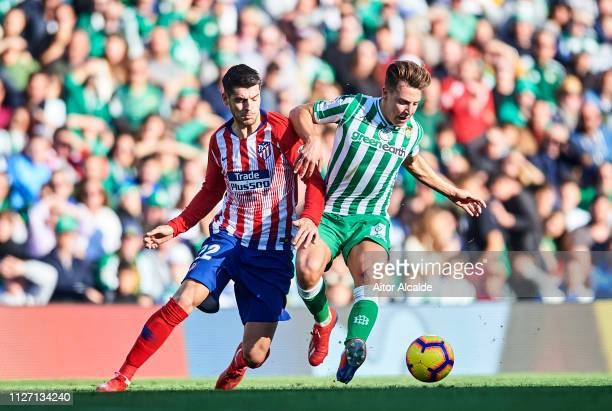 "Alvaro Morata of Club Atletico de Madrid duels for the ball with Francisco Javier Guerrero ""Francis"" of Real Betis during the start the La Liga match..."