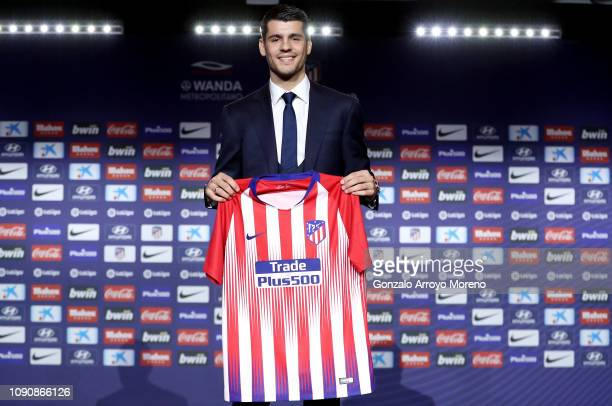 Alvaro Morata of Club Atletico de Madrid poses with his new shirt during the Club Atletico de Madrid player presentation of Alvaro Morata at Wanda...