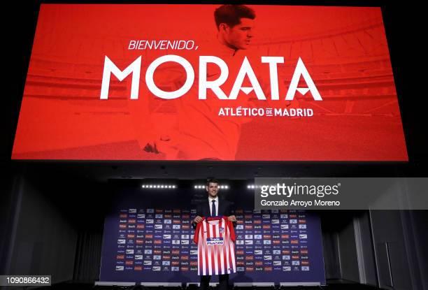 Alvaro Morata of Club Atletico de Madrid poses with his new shirt during the Club Atletico de Madrid player presentation of Alvaro Morata at Wanda...