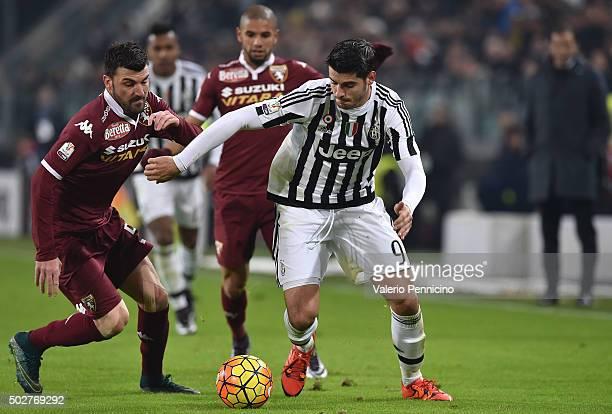 Alvaro Morata of FC Juventus in action against Cesare Bovo of Torino FC during the TIM Cup match between FC Juventus and Torino FC at Juventus Arena...
